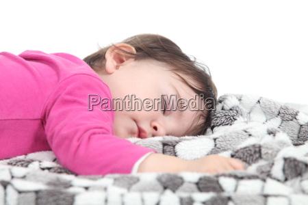 bambino che dorme su una coperta