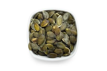 semi di zucca arrostiti in ciotola